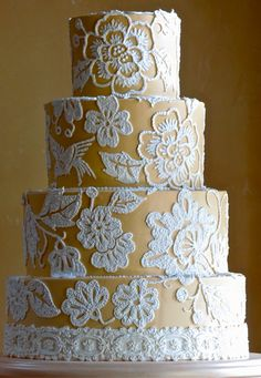 Mustard yellow vintage wedding cake with lace detail on each layer! Wedding Cakes by Jim Smeal