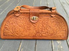 Hey, I found this really awesome Etsy listing at https://www.etsy.com/listing/467809647/hand-tooled-leather-handbag-vintage-hand