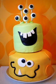 *Monster Cake for first birthday? Eyes on green monster are Tootsie Pops covered in fondant.