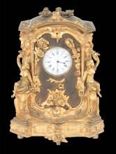 Louis XV bronze ormolu mantle clock with figures of women on each side and floral decorations in the center, 6