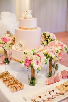 Wedding dessert table with bridesmaids arrangements for decoration and keeping in water