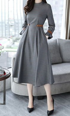Tiffany is a classy mid length plaid dress with foldable vintage bubble sleeves and belted detail available in S-2XL.