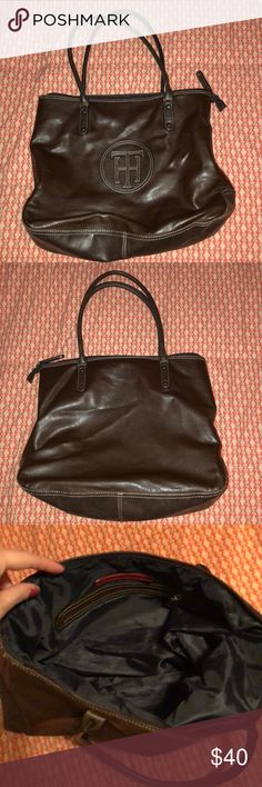 Tommy Hilfiger Brown Leather Tote/Purse Logo on front, zippered closure.   Clean. Like new condition. Comes from a smoke-free home.   Contact me with any questions and I'll be happy to help! Thanks! Tommy Hilfiger Bags Totes