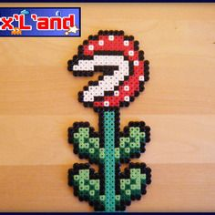 Pirahna plant hama midi beads by Pixel Land