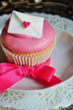Nothing says love like pink cupcakes! Make her Valentine's Day with these super cute cakes.