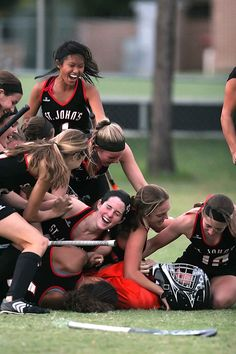Field Hockey Champions. This has happened to our team before. Best feeling in the world for a goalkeeper is to be tackled in victory by her team. :)