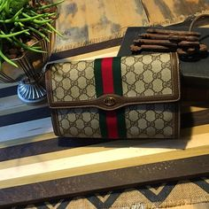 Gucci vintage clutch. Measures 10 in across, 6 inches tall and 3 inches wide. This item is in pristine condition all wax edges are intact. Inside is not peeling but has a one small Penmark, EXCELLENT condition!!! The bottom has a small mark very very small and not noticeable when carrying. Comes with original dust bag. 100% authentic...Number #89.01.006. Bundle in my closet save 10% off your total purchase. I ship same day or next day always! Thank you for checking out my close. Gucci Bags…