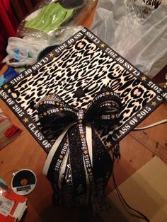 Leopard print base with ribbons and a bow for decorating a graduation cap