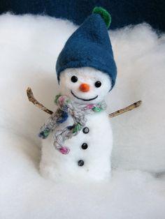 Bonhomme de neige en laine feutrée piquée.