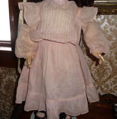 Beautiful antique pale pink doll dress for medium to large doll