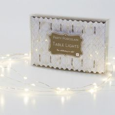 A string of dainty gold party table LED lights to brighten up any table for weddings, Christmas and parties. Twist around branches or fix along a table runner.