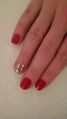 Opi red with chunky glitter feauture nail