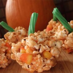 "Halloween Popcorn Pumpkins | ""Popcorn balls are colored orange and made to look like pumpkins. These are a fun Halloween treat for kid and adult parties. Very versatile!"""