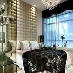 bedrooms - luxe tall tufted headboard crystal chandelier flokati rug  modern luxe  tufted headboard wall, crystal chandelier, pink bedding and