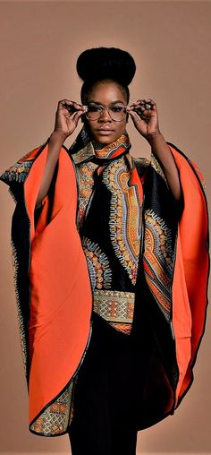Luxury has arrived with this comfortable Unisex African print Poncho, fully lined with cashmere to keep you warm. Wear it over a coat or a sweater Its edges are Trimmed with Pleather, A perfect gift for Valentine. African Print Dresses, African Dresses For Women, African Print Fashion, Africa Fashion, African Wear, African Attire, African Fashion Dresses, Ethnic Fashion, African Women