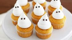 Ghostly pumpkin cupcakes with a boozy rum cream filling inside are perfect for your adult Halloween party!