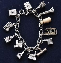 Sterling Silver Stanhope Charm bracelet.  Each small little tube shows an image that relates to the three dimensional charm - sometimes there will be more than one image, as is the case for the Status of Liberty Charm. Explore the individual images in the charmses gallery. (Group 3174).