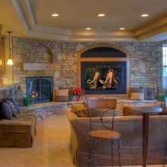 I love the use of the wall space, and also a seating area by the fire.