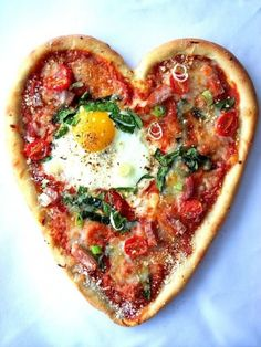 You can bake a Mini Heart-Shaped Cracked Egg Pizza for breakfast on Valentine's Day with this recipe.