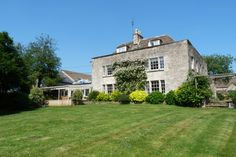 The view of the Tythe House from its bottom lawn - the Breakfast room can be seen just to the left of the House