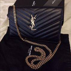 YSL monogram WOC LIKE NEW CONDITION. COMES WITH DUSTBAG, BOX AND CARDS. CLASSIC SAINT LAURENT FLAP FRONT WALLET WITH REMOVABLE METAL CHAIN, METAL INTERLOCKING YSL SIGNATURE AND MATELASSÉ STITCHING. HANDLE DROP: 48CM DIMENSIONS 8.8 5.5 1.6 INCHES 100% CALF-SKIN LEATHER GOLD-TONED HARDWARE 20 CARD SLOTS, 1 COIN POCKET 2 BILL & 2 RECEIPT COMPARTMENTS STYLE ID 377828BOW016920 MADE IN ITALY Yves Saint Laurent Bags