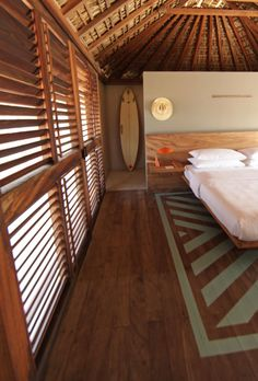 open air bungalow with thatch roof. I like the painted pattern on the wood floor boards which ads color and style. Surf Decor, Decoration Surf, Surf House, Beach House, Style At Home, Style Surf, Beach Shack, Surf Shack, Beach Cottage Style