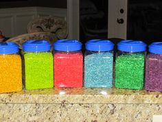 For sensory table: Coloring rice using Kool-Aid instead of rubbing alcohol and food coloring to avoid that strong rubbing-alcohol smell.