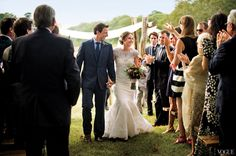 Anchors Aweigh - Meyers, in Ralph Lauren Black Label, and Ashe, in custom Carolina Herrera, walking down the aisle.