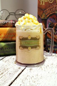 best butterbeer recipe: ice cream, cream soda, imitation butter extract, rum extract, butterscotch topping, whipped cream