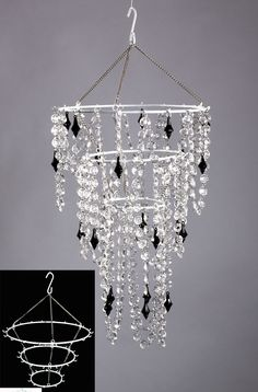Create your very own chandelier decoration using our white metal frame! Just add your own beads, flowers, or anything you'd like! We have a HUGE selection of Bead Strands and