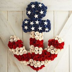 Anchors aweigh! Get ready for everyone to salute your style when you add our red, white and blue wood curl decoration to a door or wall inside or on a covered patio,