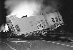 A Marina house was thrown out in the street by the force of the Loma Prieta earthquake, as a fire from anther home blazed behind it. The location was Northpoint and Divisadero in San Francisco. Photo: Frederic Larson, The Chronicle