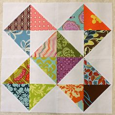 """I'm thinking this is definitely the one for my One Scrappy Bee quilt!  I know it's not very complicated or challenging but I love how the simple design lets all the colors and patterns shine.   The block is from this pattern without the squaring up of squares to 4 1/2"""" (I don't want to waste another quarter inch of my scraps). So the unfinished block comes to a 17"""" square."""