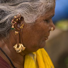Hindu Woman With Several Earrings And Rings Hung At Her Ears, Madurai, India India Jewelry, Tribal Jewelry, Gold Jewelry, Jewellery, Vintage India, Madurai, Gold Diamond Earrings, Body Modifications, People Around The World