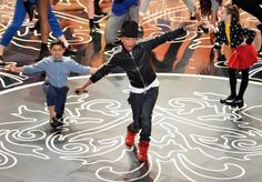"Can't nothing bring him down. GRAMMY winner Pharrell Williams soars during a performance of his hit ""Happy"" — which was up for Best Original Song — on the 86th Academy Awards on March 2 in Hollywood, Calif."