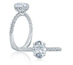 This solitaire engagement ring features a tight twist shank, an oval center stone, and the A.JAFFE Signature Shank.