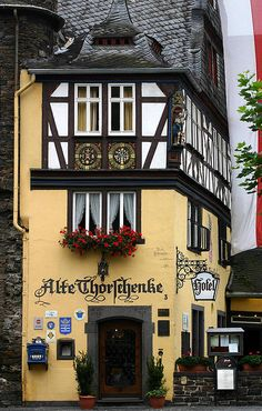 Cochem, Germany  Look at the sweet details of the pulled back lace curtains and the window boxes.