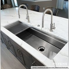 The Legacy Undermount Sink adds a touch of sophisticated style to this breathtaking kitchen island. The classic detailing of the Prestige Stainless finish is the perfect timeless finish for this design. FB/PIN HASHTAG #kitchen #kitchensink #interiordesign #luxurykitchen #luxuryhouse #millionarehomes Undermount Stainless Steel Sink, Stainless Steel Cleaner, Stainless Steel Types, Undermount Sink, Stainless Kitchen, Bath Showroom, Sink Accessories, Washing Dishes, Home Renovation