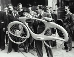 """British born Benjamin Bowden originally designed the futurist Spacelander bicycle for the """"Britain Can Make It"""" exhibition in 1946. Conceived in aluminum, the dynamic form featured a direct drive hub dynamo that stored the downhill energy and released it on uphill runs."""