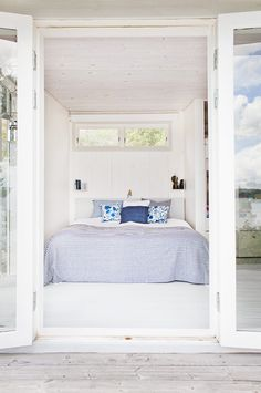 Tiny Bedroom in Swedish Cottage I Remodelista: Summer cottages are typically tiny with little wiggle room in the bedrooms. Skip the bedside tables and instead use a favorite Scandi device: wall shelving as storage. Swedish Cottage, House Interior, Summer House Inspiration, White Washed Floors, Home, Tiny Bedroom, Cottage Bedroom, Home Bedroom, Home Decor