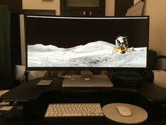 Dell 34 Ultrawide Monitor powered by MacBook Pro on a Vari-desk Pro Setup
