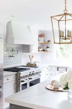 Come see our newly remodeled kitchen with white shaker style overlay cabinets from Diamond's Montgomery line (they're the perfect shade of white!)