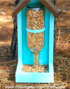 Give back to our feathered friends this spring with a craft built just for them. This wine bottle bird feeder from Down Home Inspiration is on our project list! | Wine Sisterhood