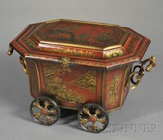 Victorian Japanned Coal Scuttle, England, 19th century, sarcophagus-shaped, red ground decorated with embossed and gilded Chinoiserie motifs and scenes, hinged lid, handled metal insert, and two scrolled side handles, on four wheels.