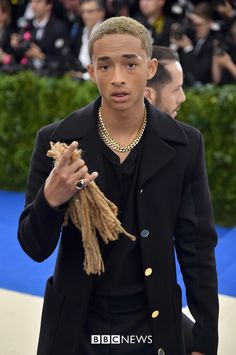 Jaden Smith carries an unusual date – his old dreadlocks, cut off for a film role two weeks ago – allegedly because his sister Willow couldn't make this year's Met Gala.