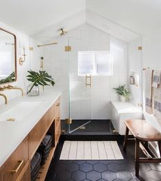 modern master bathroom A bathroom transformation by Casework featuring Hudson Valley Lighting Wentworth sconce & gorgeous hexagon tile Wood Bathroom, Bathroom Renos, White Bathroom, Bathroom Flooring, Modern Bathroom, Small Bathroom, Bathroom Ideas, Bathroom Renovations, Bathroom Plumbing
