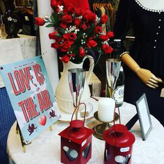 Love is in the air - detail from the Moorland Road Charity Emporium shop window, dressed for Valentine's.