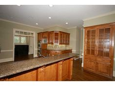 Spacious kitchen, opens to family room, features granite counter tops, breakfast bar, custom cabinetry and stainless steel appliances. *Contact Karen Cannon Realtors 770-352-9658