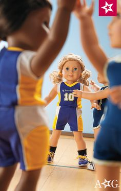 Basketball Outfit. Her Truly Me™ doll will be ready to shoot hoops in this active outfit! Includes:  • A blue-and-yellow basketball jersey with her number on the front  • Matching knee-length sport shorts • Black knit socks • Blue athletic shoes with yellow laces • Two yellow terry hairbands • A doll-sized basketball $34