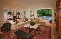 Large Family room opens up to the private pool and large yard.